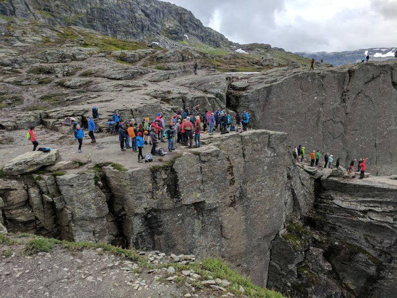 A queue of people waiting to have their photo taken on Trolltunga