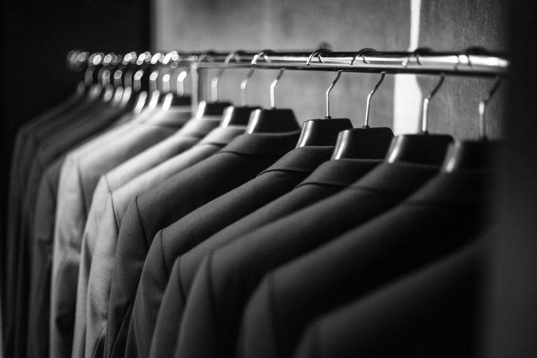 Row of suits on a rack